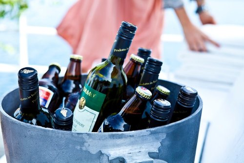 Bucket filled with alcohol bottles