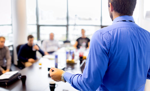 Person standing in meeting room