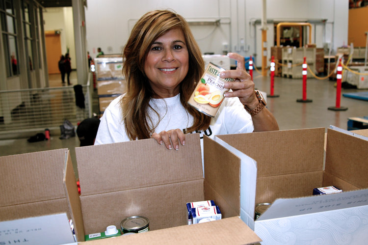 Woman holding canned food