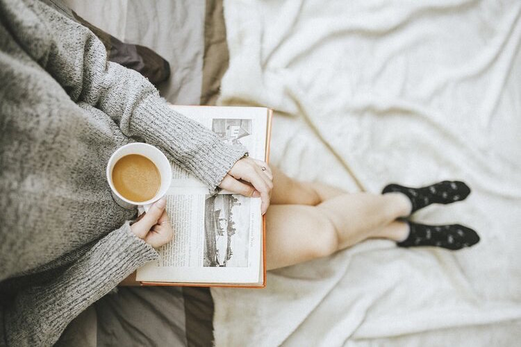 Person drinking coffee and reading