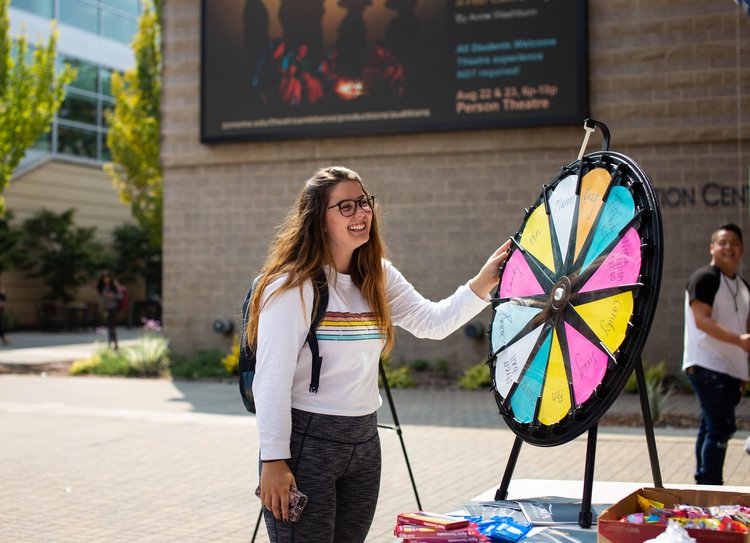 person spinning prize wheel