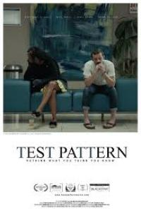The 'Test Pattern' film poster featuring two people sitting indoors on a blue seat with paintings in the background