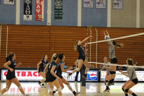 Students spiking the volleyball