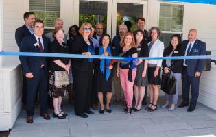 Campus and community officials cut the ribbon on the faculty, staff housing Marina Crossing
