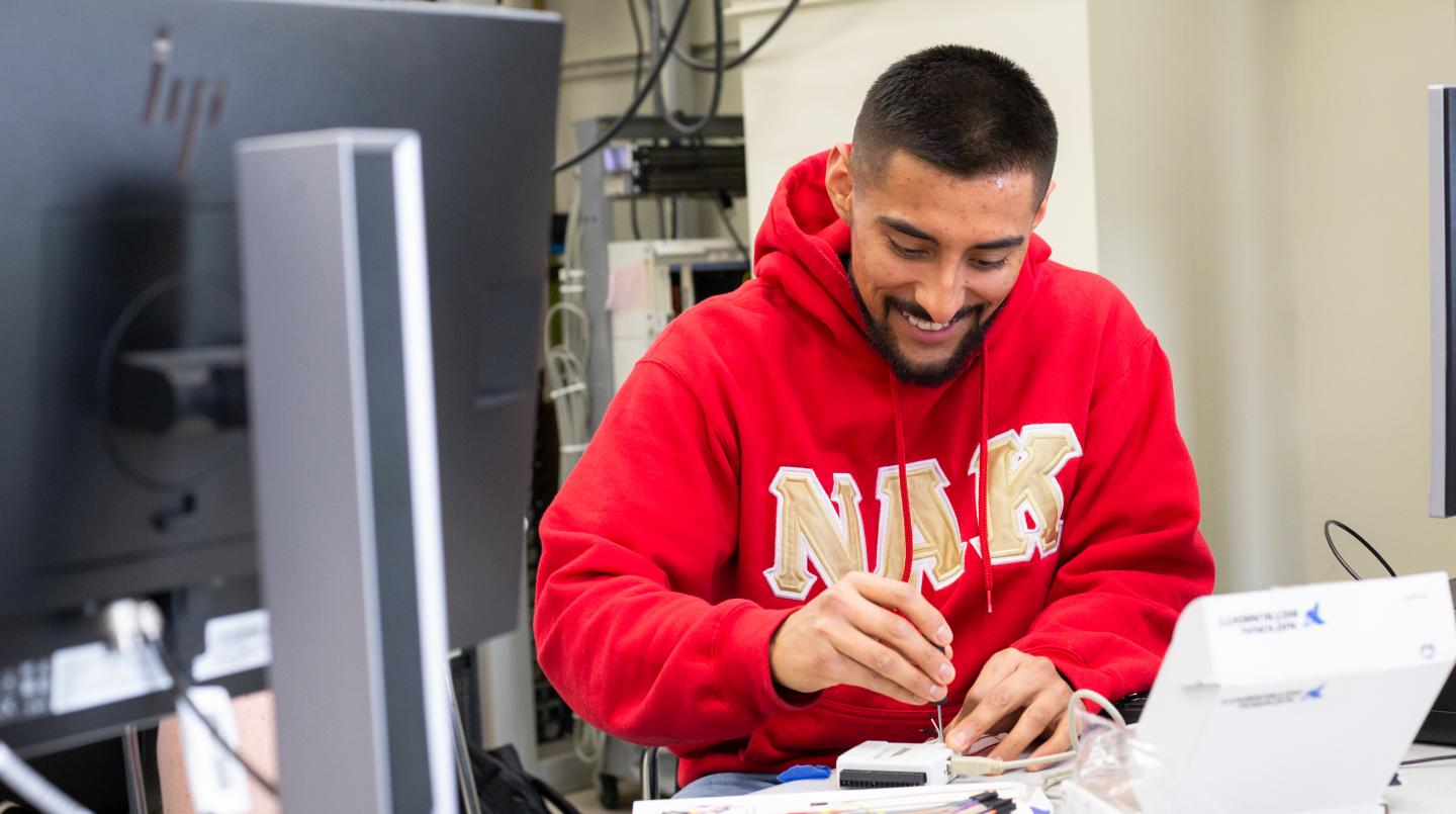 Student working on a  project in an electrical engineering lab