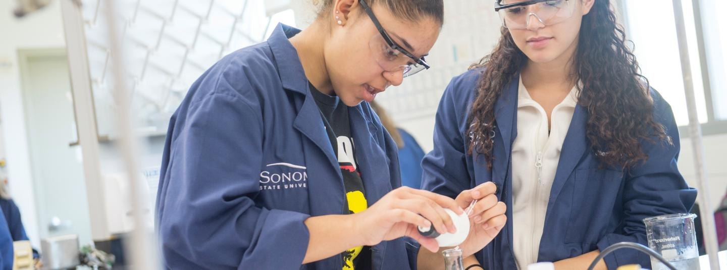 Two female students in Chemistry Lab.