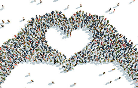An aerial graphic of a crowd of people forming together to create the shape of two hands put together to form a heart