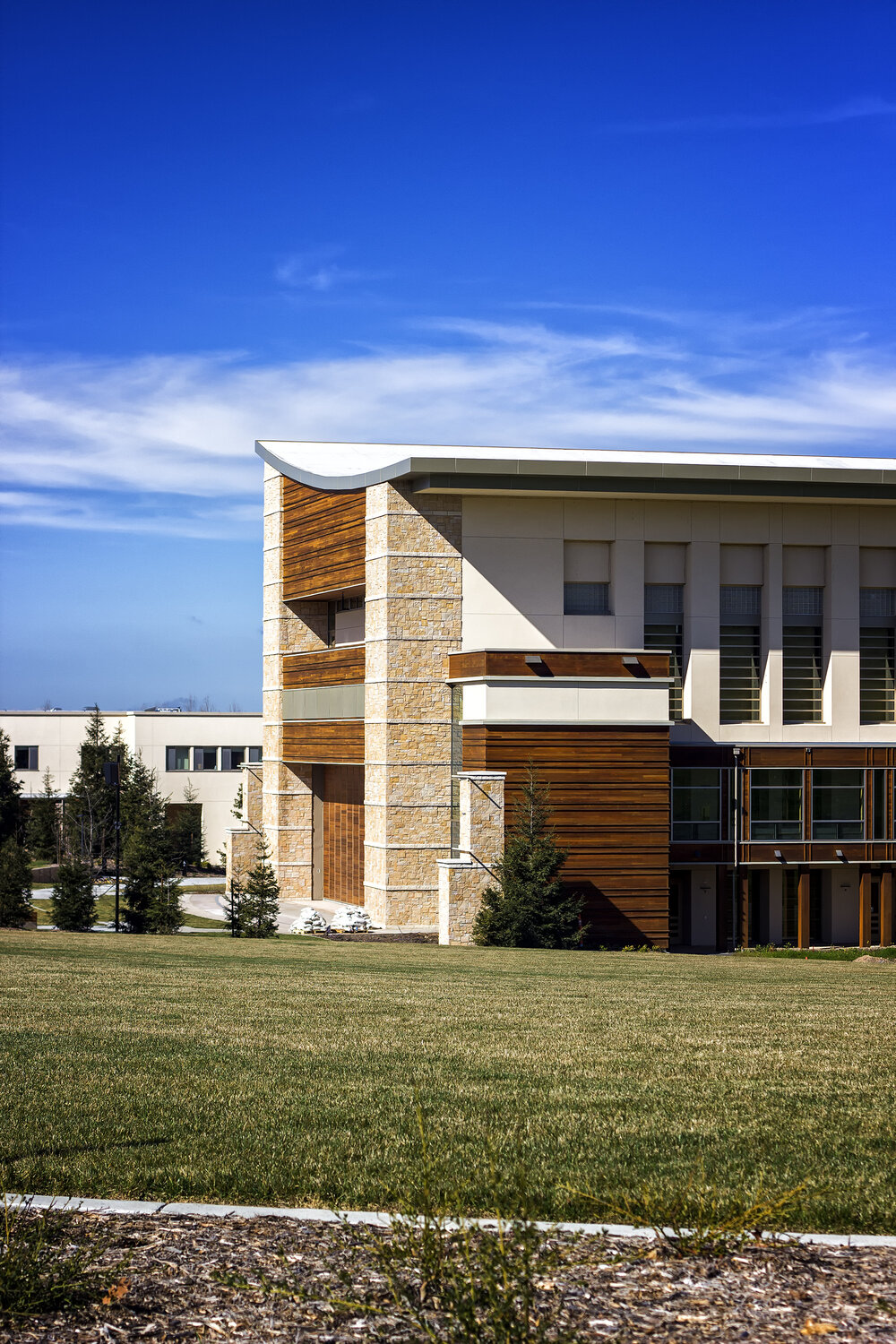 A view of the exterior of the Green Music Center on a sunny day with green grass in the foreground and blue skies in the background