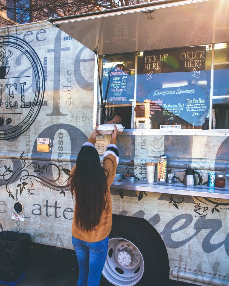 Person being handed food from food truck