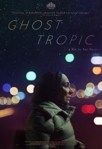 Movie poster for Ghost Tropic featuring the profile of a person dressed warmly at night with colorful lights in the background