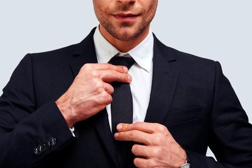 Person adjusting their tie
