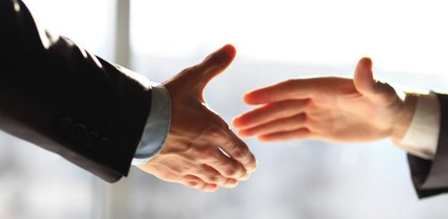 Two people about to shake hands