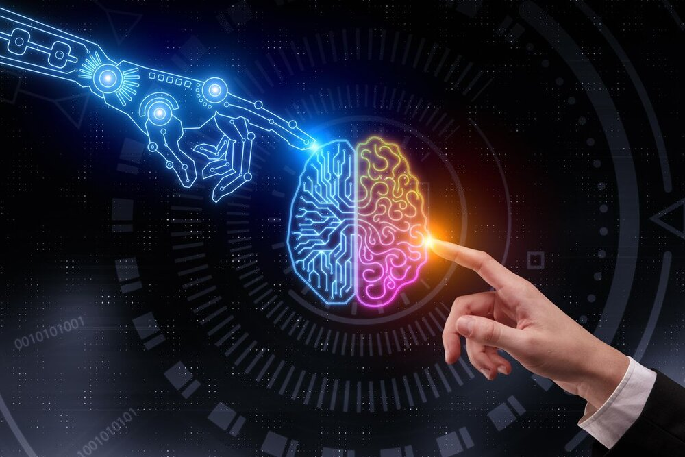 A human hand and a robot hand both using their index finger to touch a pink, orange, and blue brain in the center of the image