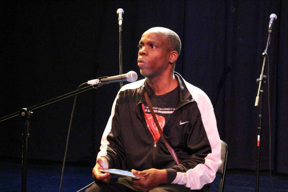 Leroy F. Moore Jr. speaking on stage