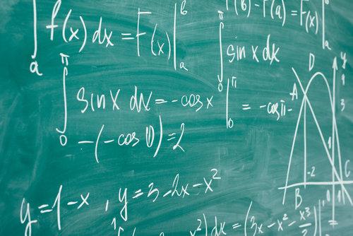 Math formulas on a chalkboard