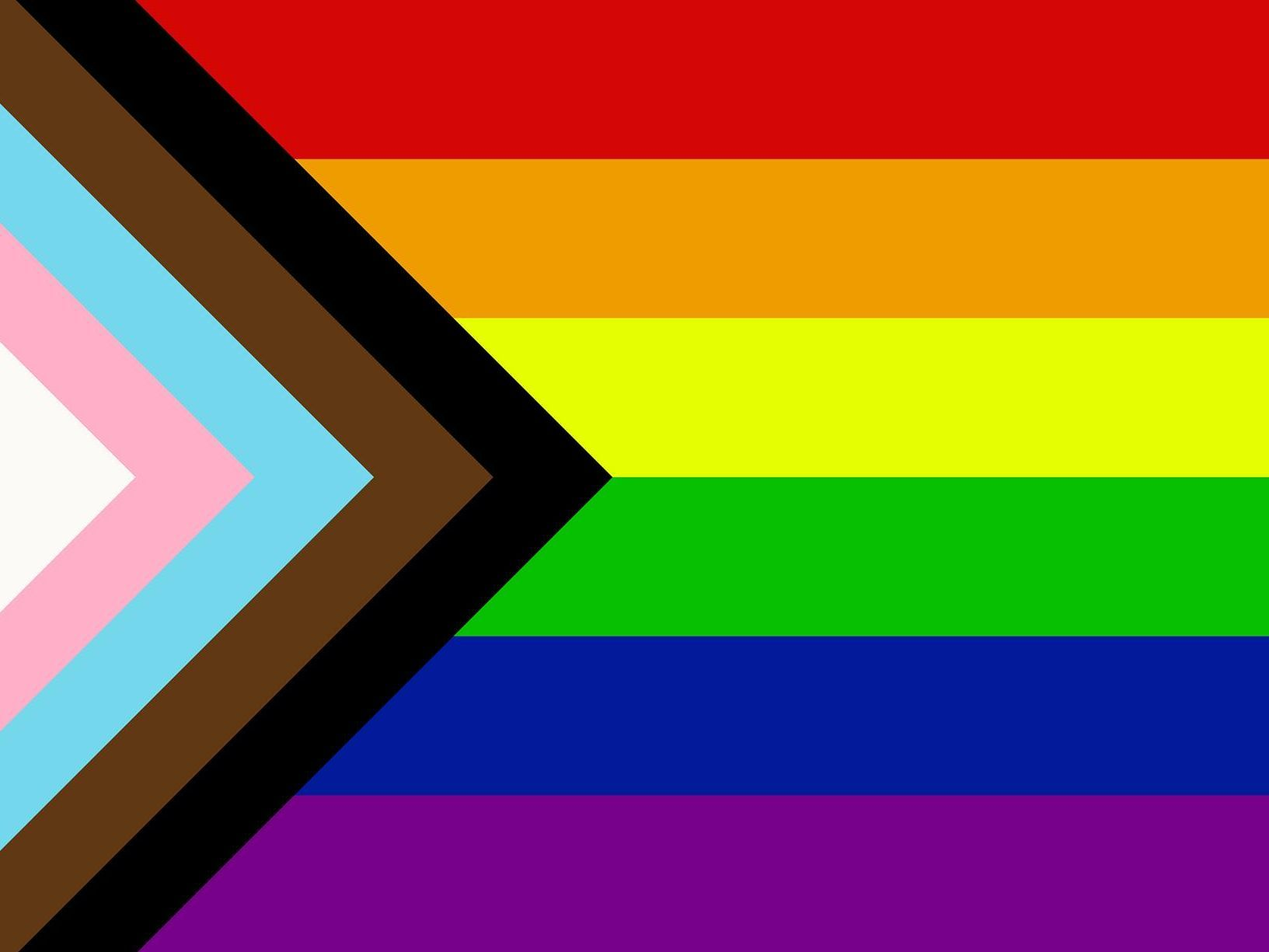 The LGBTQA flag, featuring the colors white, pink, light blue, brown, black, red, orange, yellow, green, blue, and purple