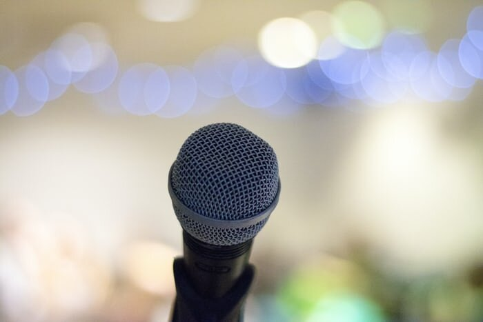 A microphone with colorful bokeh in the background