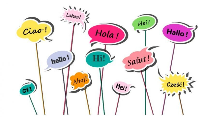"""A graphic illustration of several multicolored speech bubbles with the word """"hello"""" inside of them in different languages"""