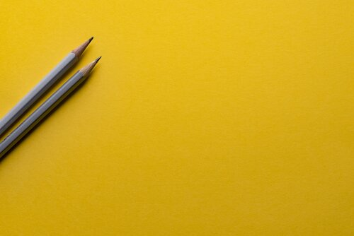 Pencils against a yellow backdrop