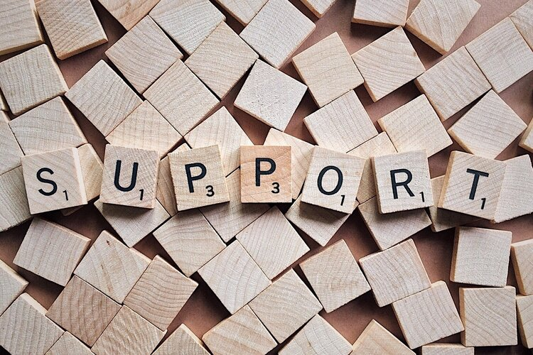 """Scrabble pieces spelling out the word """"Support"""""""