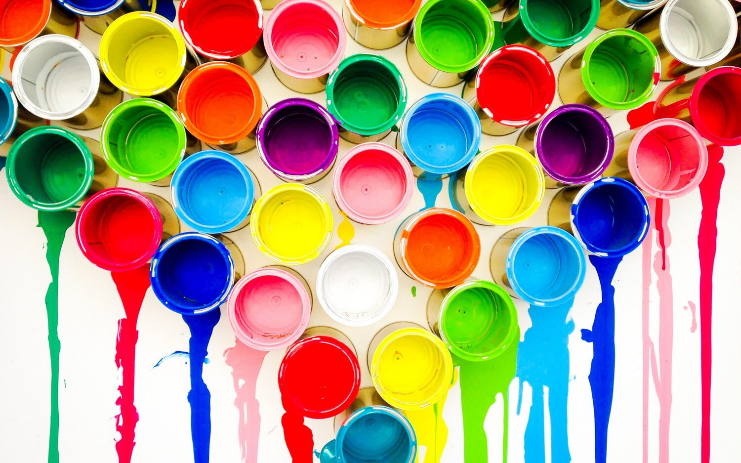 Multiple paint cans of different colors dripping paint
