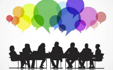 A graphic illustration of the silhouette of a panel of people sitting around a table with different colored speech bubbles above them