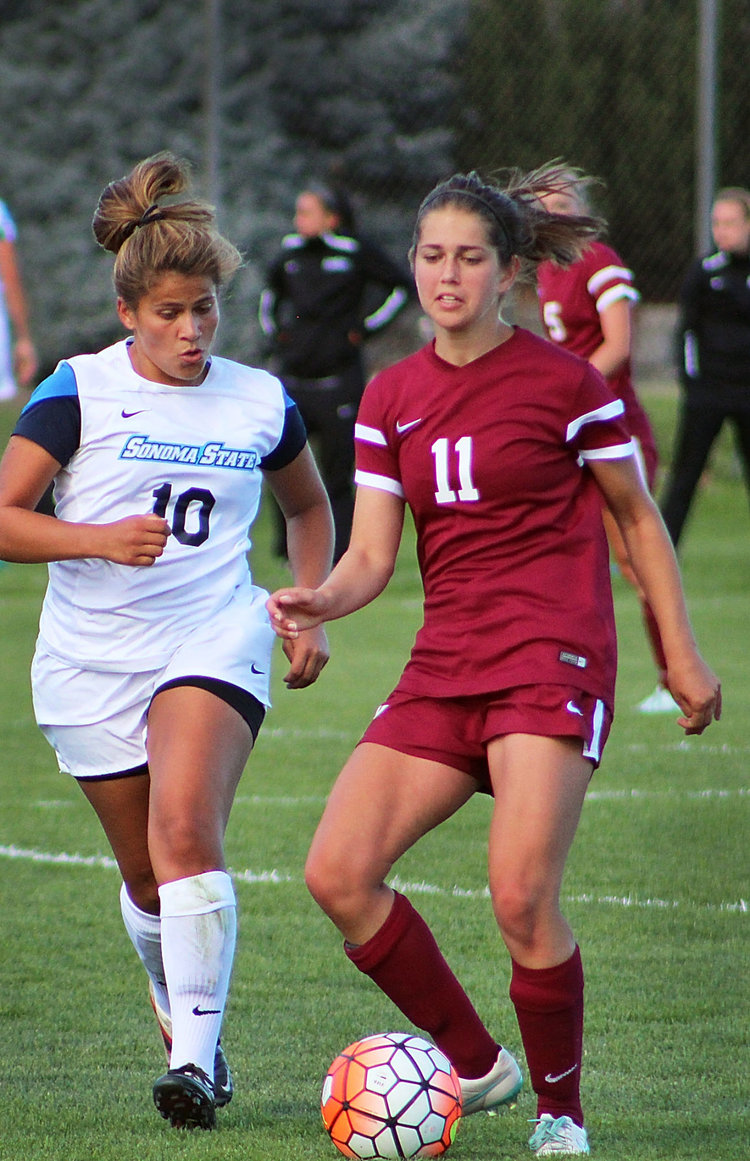 Two women playing soccer