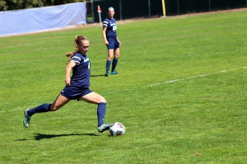 Student kicking a soccer ball