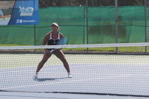 Student athlete playing tennis